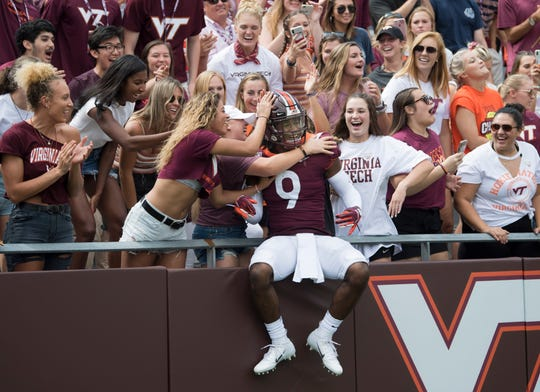 Virginia Tech Hokies Khalil Ladler (9) leaps into the crowd prior to kickoff during game against The Old Dominion Monarchs at Lane Stadium.