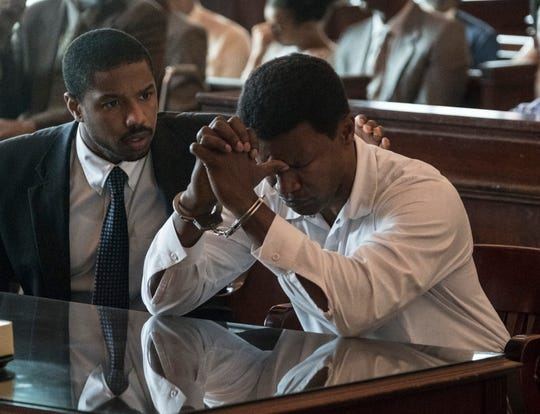 "Bryan Stevenson (Michael B. Jordan, left) works to free wrongly imprisoned Walter McMillian (Jamie Foxx) in ""Just Mercy."""