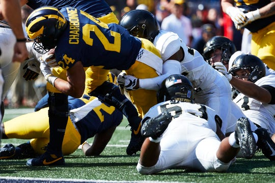 Michigan Wolverines running back Zach Charbonnet (24) dives for a touchdown in overtime against the Army Black Knights at Michigan Stadium.