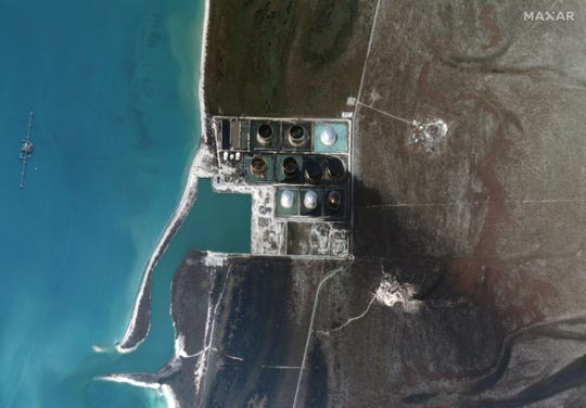 Satellite images taken Sept. 6, 2019 show a slick of black oil seeping from the South Riding Point terminal, Grand Bahama.