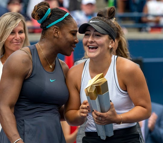 Serena Williams talks with Rogers Cup winner Bianca Andreescu. Williams retired in the final because of back issues.