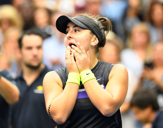 Bianca Andreescu of Canada reacts after beating Serena Williams.