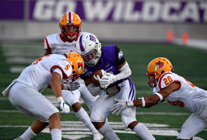 ACU wide receiver and Sweetwater grad Kobe Clark is surrounded by Arizona Christian defenders during last year's game at Wildcat Stadium.