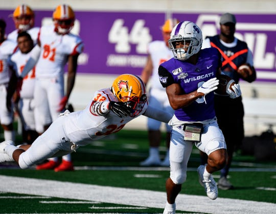 ACU wide receiver Justus Lee outruns Arizona Christian defensive back Clay Branton during Saturday's game at Abilene Christian University.