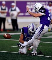 The football leaves grip of placeholder Brendan Harmon as ACU's Blair Zepeda kicks it to Arizona Christian during Saturday's game at Abilene Christian University.