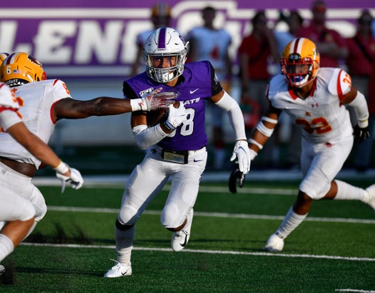 ACU wide receiver Kobe Clark takes the ball downfield against Arizona Christian during the nonconference game Sept. 7 at Abilene Christian University's Wildcat Stadium.