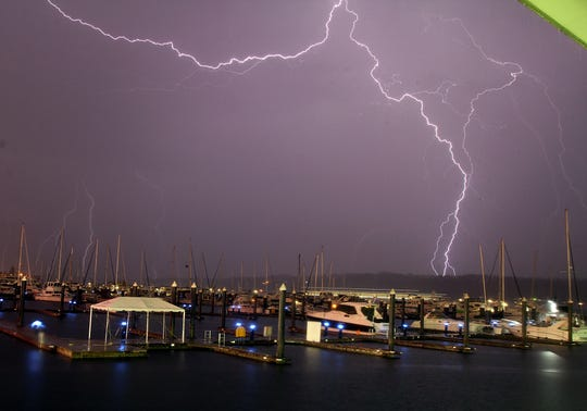 A rare lightning storm lights up the sky above the Bremerton Harborside Marina on Saturday, September 7. The storm covered Western Washington for several hours and recorded hundreds of lightning strikes in the region.