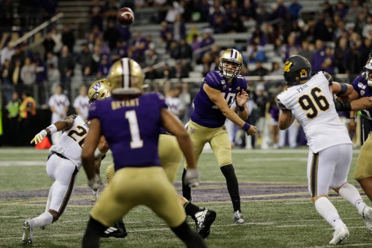 Washington quarterback Jacob Eason, center, passes to tight end Hunter Bryant (1) during the first half of an NCAA college football game against California, Saturday, Sept. 7, 2019, in Seattle.