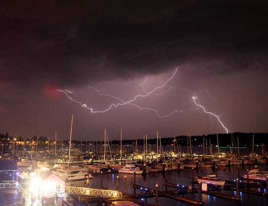 A rare lightning storm lights up the sky above the Bremerton Harborside Marina on Saturday, September 7. The powerful storm covered Western Washington with heavy rain, hundreds of lightning strikes, power failures and a lengthy delay of the football game at the University of Washington.