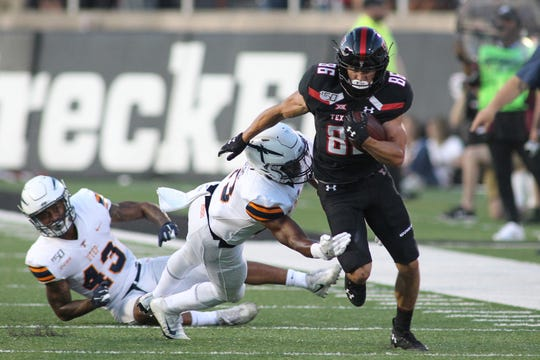 Sep 7, 2019; Lubbock, TX, USA; Texas Tech Red Raiders wide receiver Dalton Rigdon (86) is tackled by Texas El Paso Miners free safety Justin Rogers (13) in the first half at Jones AT&T Stadium. Mandatory Credit: Michael C. Johnson-USA TODAY Sports
