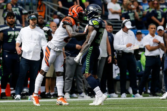 Cincinnati Bengals cornerback Dre Kirkpatrick (27) draws a penalty after shoving Seattle Seahawks running back Chris Carson (32) in the second quarter of the NFL Week 1 game between the Seattle Seahawks and the Cincinnati Bengals at CenturyLink Field in Seattle on Sunday, Sept. 8, 2019.