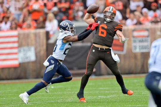 Cleveland Browns quarterback Baker Mayfield (6) is under pressure from Tennessee Titans cornerback Logan Ryan (26) during the first half in an NFL football game, Sunday, Sept. 8, 2019, in Cleveland.