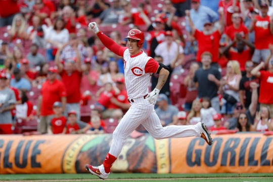Cincinnati Reds' Michael Lorenzen runs the bases after hitting a game-winning RBI double off Arizona Diamondbacks relief pitcher T.J. McFarland in the ninth inning of a baseball game, Sunday, Sept. 8, 2019, in Cincinnati.