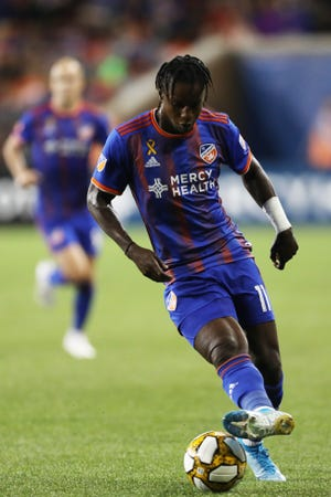 FCC forward Darren Mattocks (11) takes the ball down the field during the FC Cincinnati vs Toronto FC match on Saturday, Sept. 7, 2019 at Nippert Stadium in Cincinnati, Ohio.