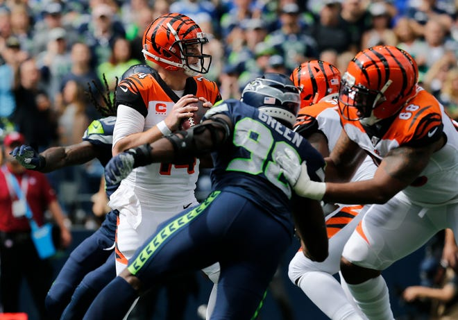 Cincinnati Bengals quarterback Andy Dalton (14) drops back in the pocket in the first quarter of the NFL Week 1 game between the Seattle Seahawks and the Cincinnati Bengals at CenturyLink Field in Seattle on Sunday, Sept. 8, 2019.