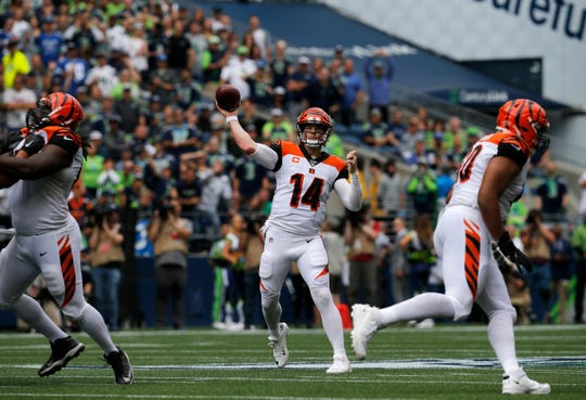 Cincinnati Bengals quarterback Andy Dalton (14) throws a touchdown pass to wide receiver John Ross (11) in the second quarter of the NFL Week 1 game between the Seattle Seahawks and the Cincinnati Bengals at CenturyLink Field in Seattle on Sunday, Sept. 8, 2019.