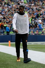 Injured Cincinnati Bengals wide receiver A.J. Green (18) takes the field in a walking boot in the first quarter of the NFL Week 1 game between the Seattle Seahawks and the Cincinnati Bengals at CenturyLink Field in Seattle on Sunday, Sept. 8, 2019.