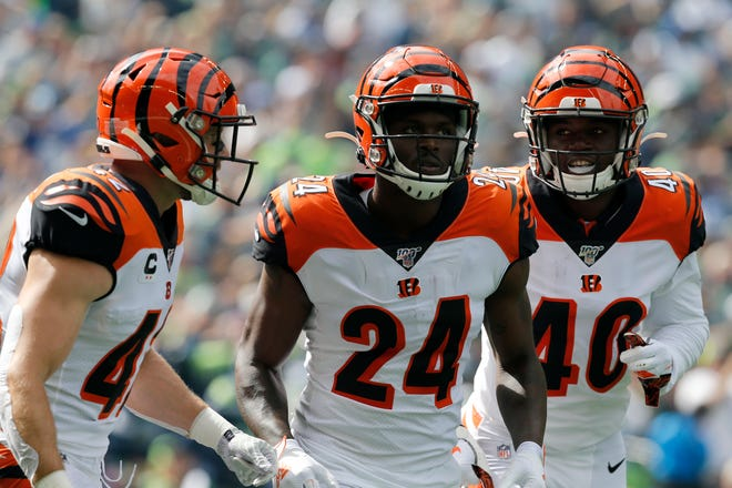 Cincinnati Bengals cornerback Darius Phillips (24) runs off the field after catching the opening kickoff in the first quarter of the NFL Week 1 game between the Seattle Seahawks and the Cincinnati Bengals at CenturyLink Field in Seattle on Sunday, Sept. 8, 2019.