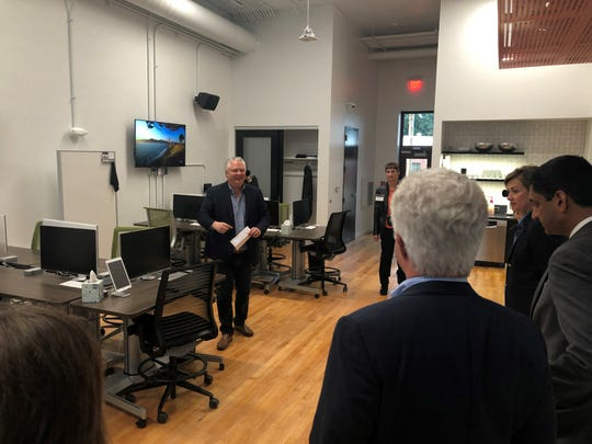 Pillar Technology executive Linc Kroeger gives Gov. Kim Reynolds, U.S. Rep. Ro Khanna of California and other leaders a tour of the company's new office in Jefferson.