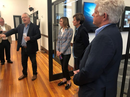 Linc Kroeger, a Pillar Technology executive, gives Corteva Agriscience's Debra King, Gov. Kim Reynolds, and Accenture's Chad Jerdee a tour of Pillar's new tech center in Jefferson.