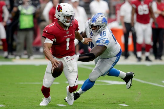 Arizona Cardinals quarterback Kyler Murray tries to elude Detroit Lions defensive lineman Mike Daniels during the first half Sunday, Sept. 8, 2019, in Glendale, Ariz.