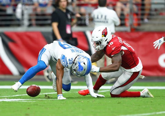 Arizona Cardinals receiver Trent Sherfield recovers a muffed punt by Detroit Lions cornerback Jamal Agnew in the second quarter Sunday, Sept. 8, 2019.