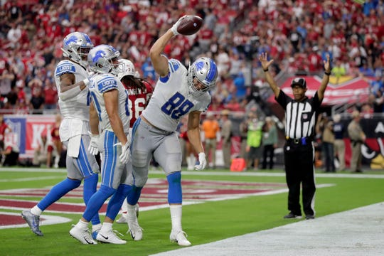 Detroit Lions tight end T.J. Hockenson (88) celebrates his touchdown against the Arizona Cardinals during the second half Sunday, Sept. 8, 2019, in Glendale, Ariz.