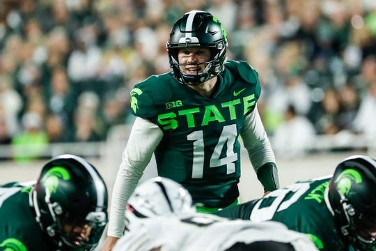 Michigan State quarterback Brian Lewerke talks to teammates before a play against Western Michigan during the second half at Spartan Stadium in East Lansing, Saturday, September 7, 2019.