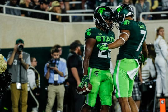 Michigan State receiver Darrell Stewart Jr., left, celebrates his touchdown against Western Michigan with teammate Cody White during the first half at Spartan Stadium in East Lansing, Saturday, September 7, 2019.