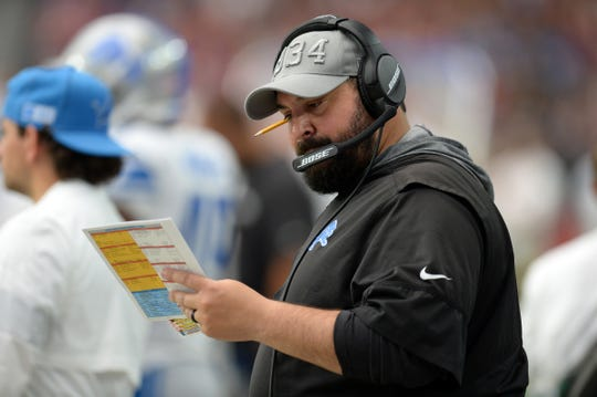 Matt Patricia looks at his play sheet Sunday in Glendale, Ariz.