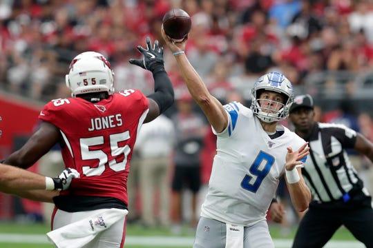 Detroit Lions quarterback Matthew Stafford throws as Arizona Cardinals linebacker Chandler Jones defends during the first quarter Sunday, Sept. 8, 2019, in Glendale, Ariz.