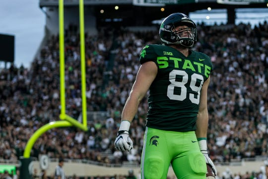 Michigan State tight end Matt Dotson celebrates his touchdown against Western Michigan during the first half at Spartan Stadium in East Lansing, Saturday, September 7, 2019.
