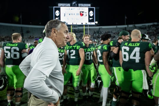 Michigan State head coach Mark Dantonio acknowledges the 51-17 win over Western Michigan to tie the school record for all-time wins by a head coach, at Spartan Stadium, Saturday, September 7, 2019.