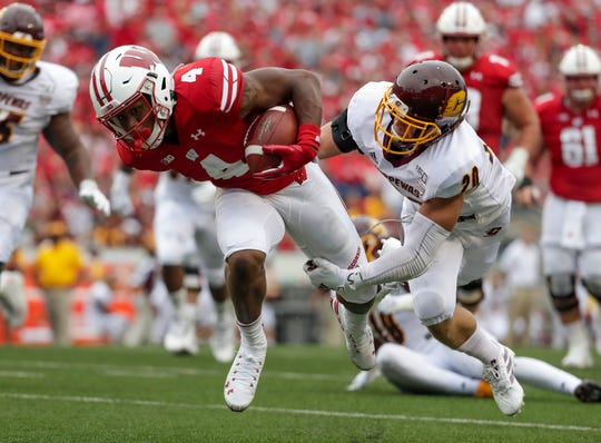 Central Michigan's Gage Kreski tries to stop Wisconsin's A.J. Taylor.