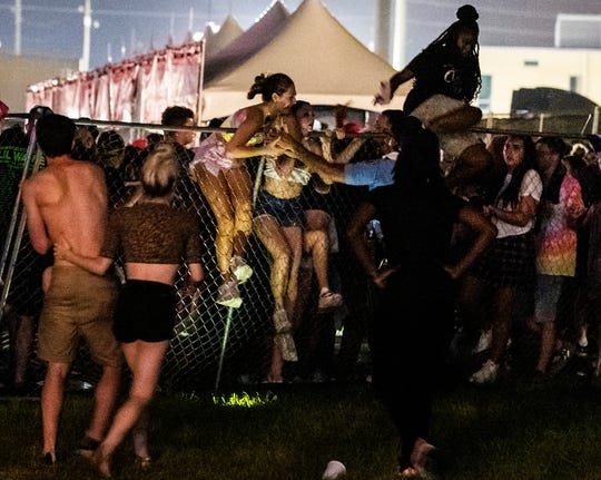 Festival-goers try to escape the crowd during Lil Wayne's fifth annual Lil WeezyAna Fest at the UNO Lakefront Arena grounds in New Orleans. A crowd stampede injured several people attending a New Orleans festival organized by rapper Lil Wayne.