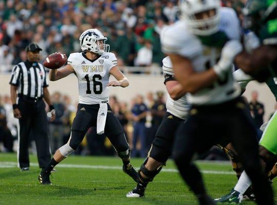 Western Michigan quarterback Jon Wassink throws a pass.