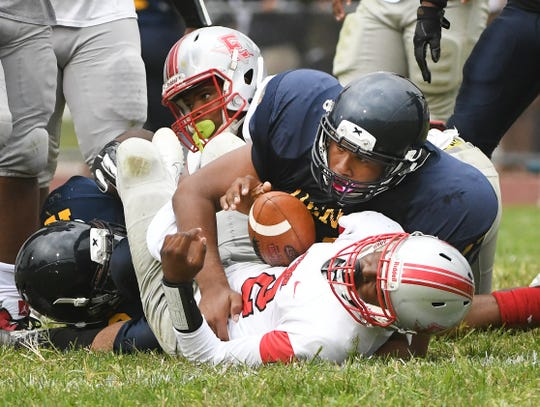 Detroit Denby's Mark Haygood sacks Ecrose's Darius Cross in the second quarter Friday. Denby is No. 5 in The Detroit News' rankings of Detroit teams.