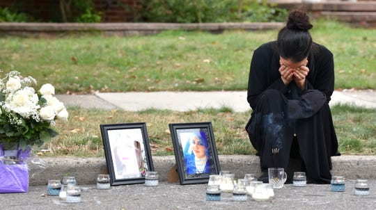Zainab Aljanabi, sister of shooting victim Saja Aljanabi, puts her hands over her face as she cries at the make-shift memorial of her slain sister.   Family members and close-family friends mourn the loss of Saja Aljanabi, Sunday afternoon, September 8, 2019, as they light candles around her memorial on Bingham St. near Morross in Dearborn. Saja was shot to death while she sat in her brother's car, here, as she came to visit the family, Friday night.