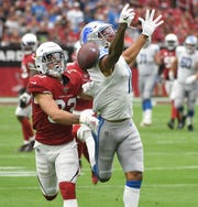 Lions' Marvin Jones Jr. can't pull in a reception with Cardinals' Byron Murphy defending late in the second quarter.