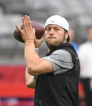 Lions quarterback Matthew Stafford warms up before the game Sunday against the Cardinals.
