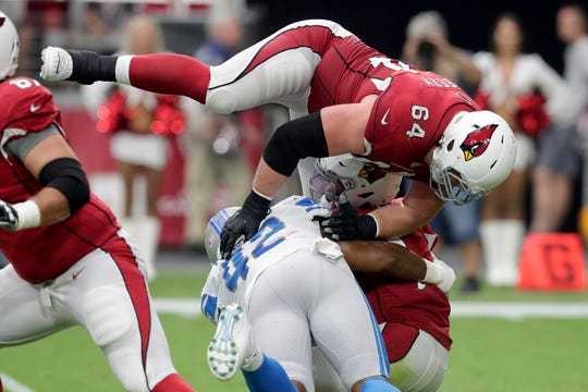 Cardinals quarterback Kyler Murray is sacked by Lions outside linebacker Devon Kennard (42) as offensive guard J.R. Sweezy (64) defends during the first quarter Sunday.