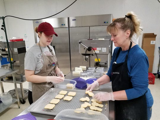 Gayla Bell and daughter Alli Gish make iced sugar cookies at Gayla Cake on Friday, Sept. 6, 2019.