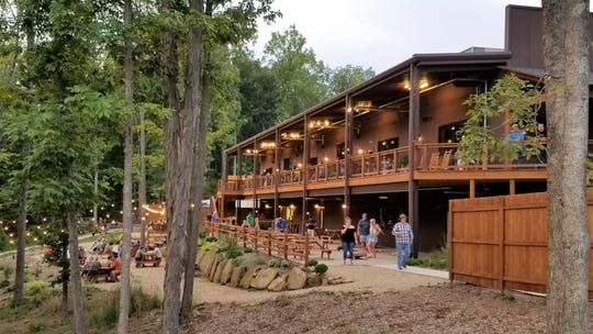 Patrons dine outdoors at Hard Truth Hills near Nashville, Ind., on Friday, Aug. 30, 2019.