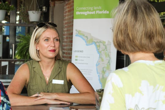 Traci Dean, Executive Director of Conservation Florida, discusses environmentalism with Tallahassee locals.