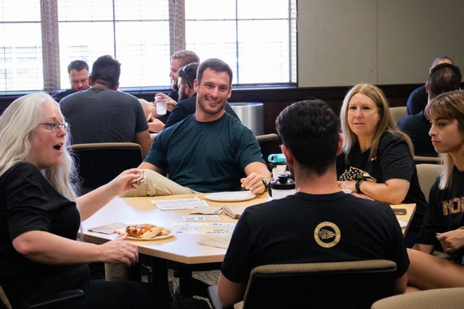 Student Veterans sharing their experiences with their peers and mentors at their monthly lunch on Friday, September 6, 2019.