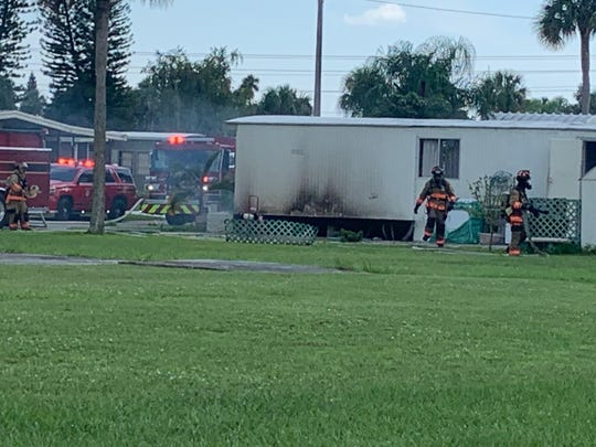 North Fort Myers Fire Department firefighters work on a trailer at a mobile home park off Slater Road where a fire caused significant damage Sunday afternoon.