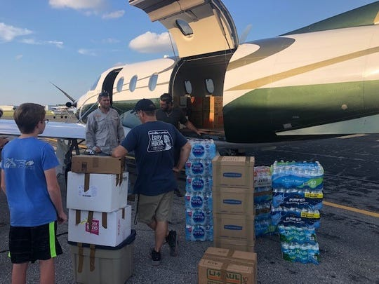 """There's a feeling of extraordinary sadness,"" Fort Myers Mayor Randall Henderson says after helping pilot supplies to Abaco Island. Henderson and Garden Street Metal owner Robert Weber ferried about 1,800-supplies to Abaco Island on Sunday."