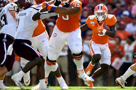 Clemson running back Travis Etienne (9) advances against Texas A&M during the first quarter at Memorial Stadium in Clemson, S.C., Saturday, Sept. 7, 2019.
