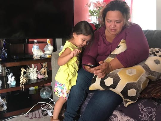 Karla Lopez scrolls through photos of Kevin Lopez with her 3-year-old daughter Perla Lopez. Kevin Lopez, 4, drowned at a recreation area of Lake Hartwell in Pickens County on Saturday, Sept. 7, 2019.