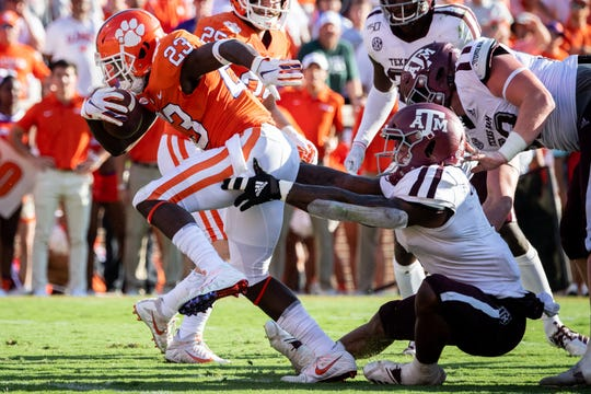 Clemson running back Lyn-J Dixon (23) scores a touchdown past Texas A&M linebacker Buddy Johnson (1) during the third quarter at Memorial Stadium in Clemson, S.C., Saturday, Sept. 7, 2019.
